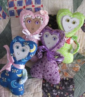 Jerrys Quilt Used as Background For Photo Shoot of Folk Heart Dolls