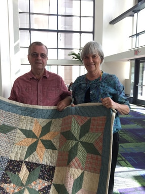 Jerry Hutchins and Merikay Waldvogel With Quilt From Jerry's Childhood at Quiltcon 2017
