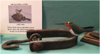 carved Humming bird Perched on antique tool by Vincent Ciesielski