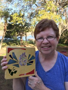 Carolyn Jenkins holding Stained Glass Garden Stepping Stone She made in Beginner's Workshop